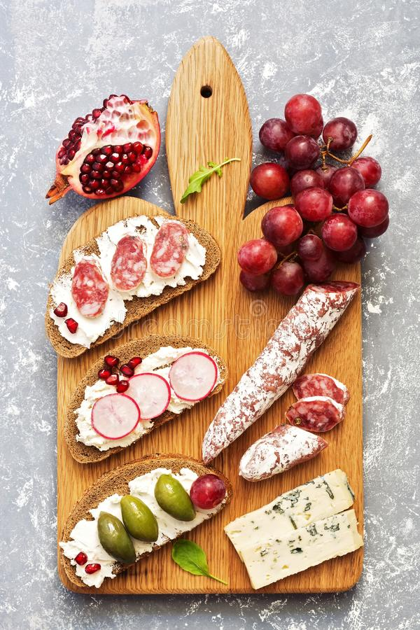 Bruschetta or authentic traditional Spanish tapas on a gray background. The view from above, flat lay. royalty free stock photography