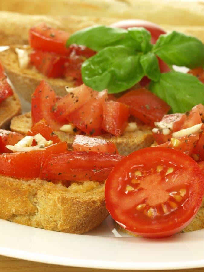Bruschetta and cherry tomatoes royalty free stock photo