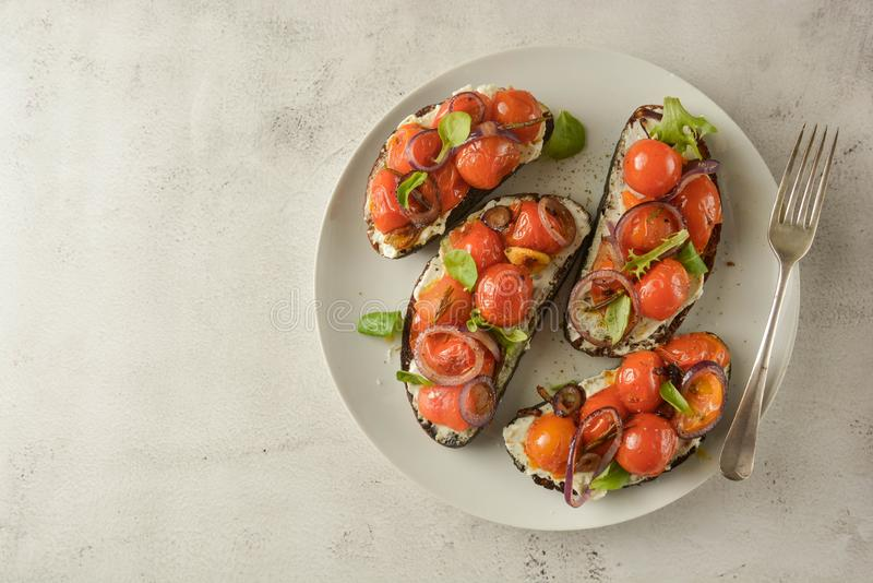 Bruschetta with cherry tomatoes and cheese cream. Healthy, vegan food, snack. Copy space. Bruschetta with cherry tomatoes and cheese cream. Healthy, vegan food stock images