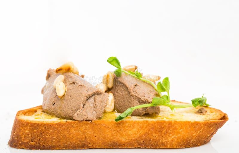 Bruschetta deliziosa con il pasticcio di fegato del pollo fotografia stock libera da diritti