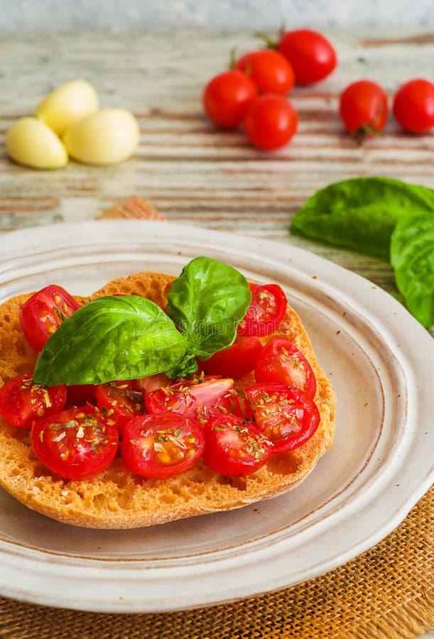 Bruschetta with fresh tomato, basil and garlic. Fresh tomato bruschetta with basil and garlic stock photos