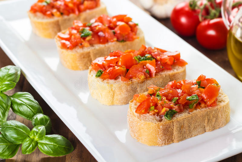Bruschetta med tomater arkivfoton