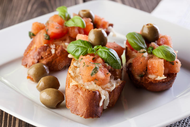 Bruschetta with olive. Selective focus stock photos