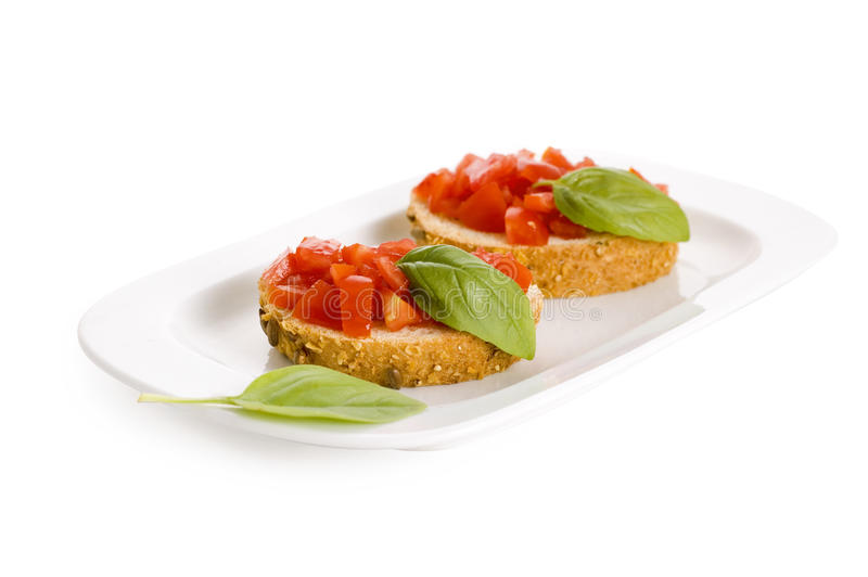 Download Bruschetta on plate stock image. Image of food, white - 15337891