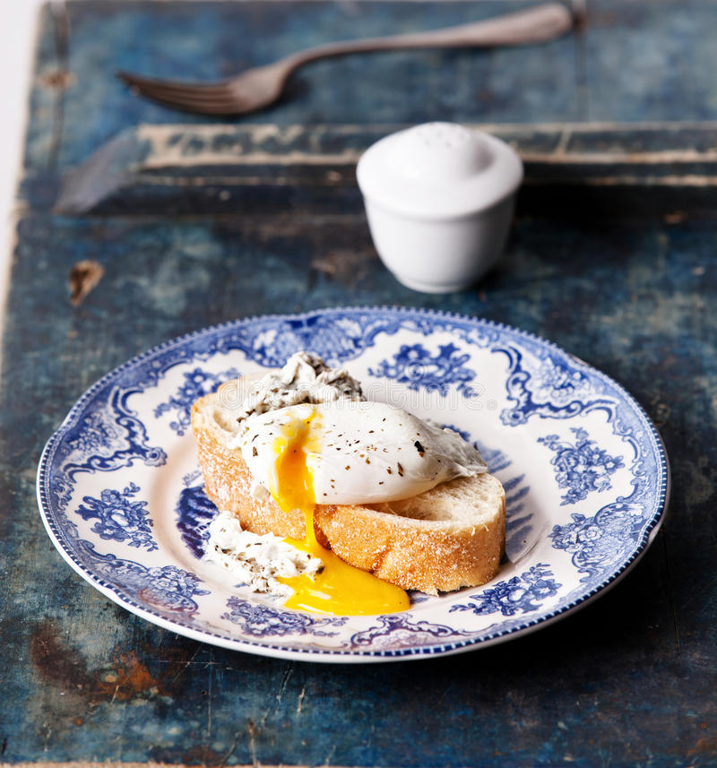 Bruschetta with poached egg stock photography