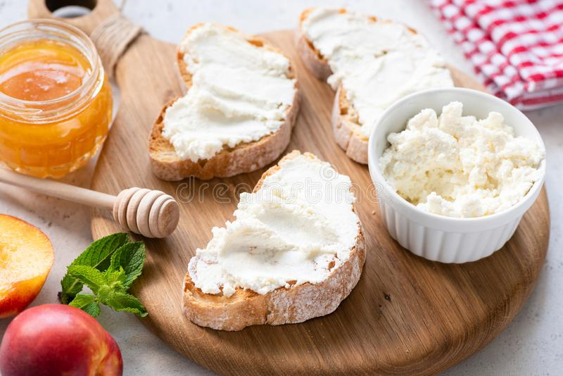 Bruschetta with ricotta cheese. On wooden board. Healthy tasty appetizer stock images
