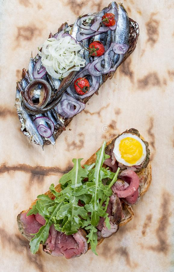 Bruschetta with roast beef and sprat royalty free stock images