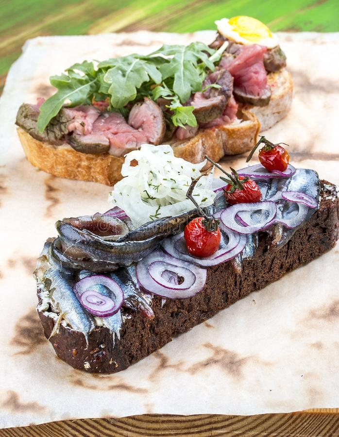 Bruschetta with roast beef and sprat royalty free stock image