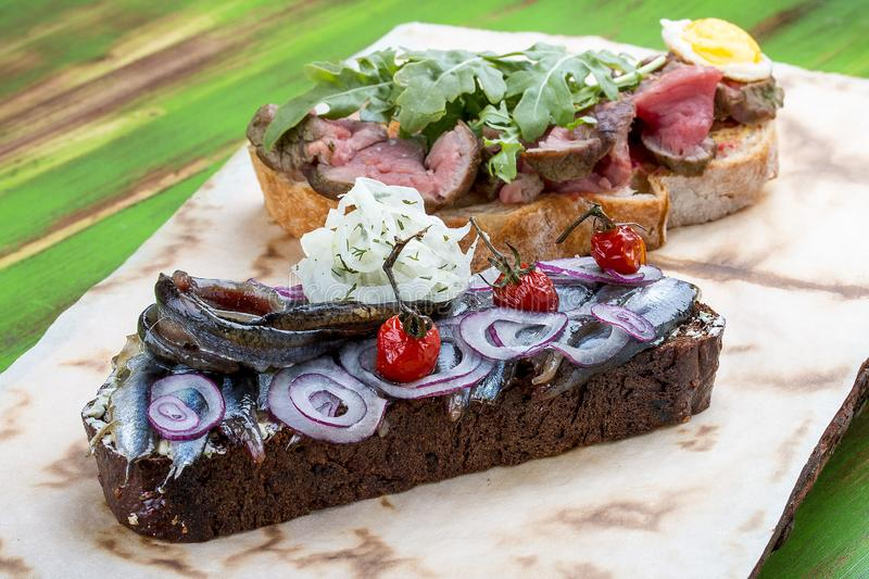 Bruschetta with roast beef and sprat stock image