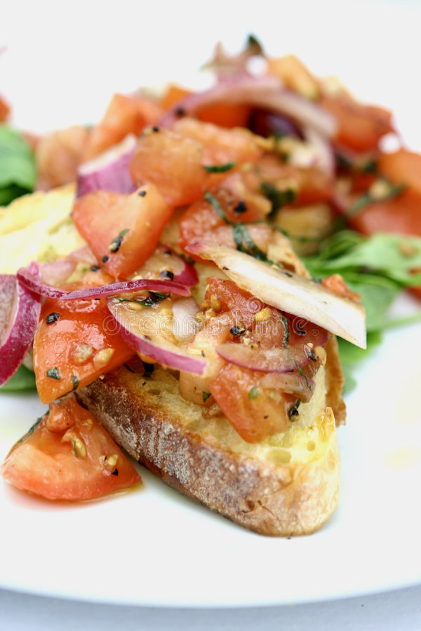 Bruschetta with sliced tomatoes royalty free stock images