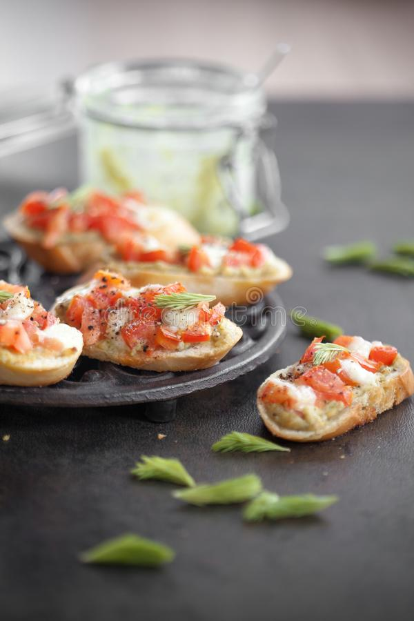 Bruschetta with spruce sprout pesto stock photography