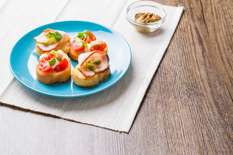 Bruschetta with tomato, cheese and bacon. Traditional Italian antipasti bruschetta with tomato, cheese and bacon stock images