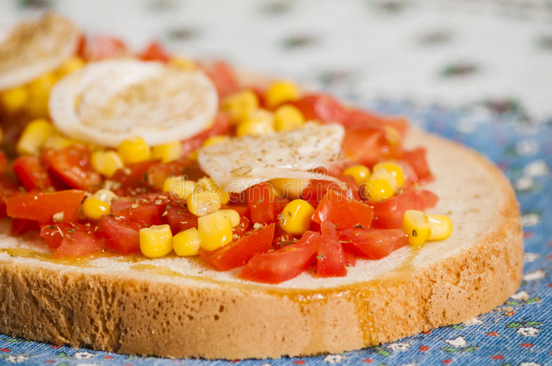 Bruschetta with tomato, onion and corn stock images