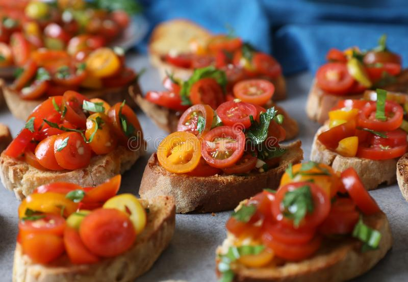 Bruschetta with tomatoes, basil and parsley,  an Italian delicious savory  appetizer. royalty free stock photography