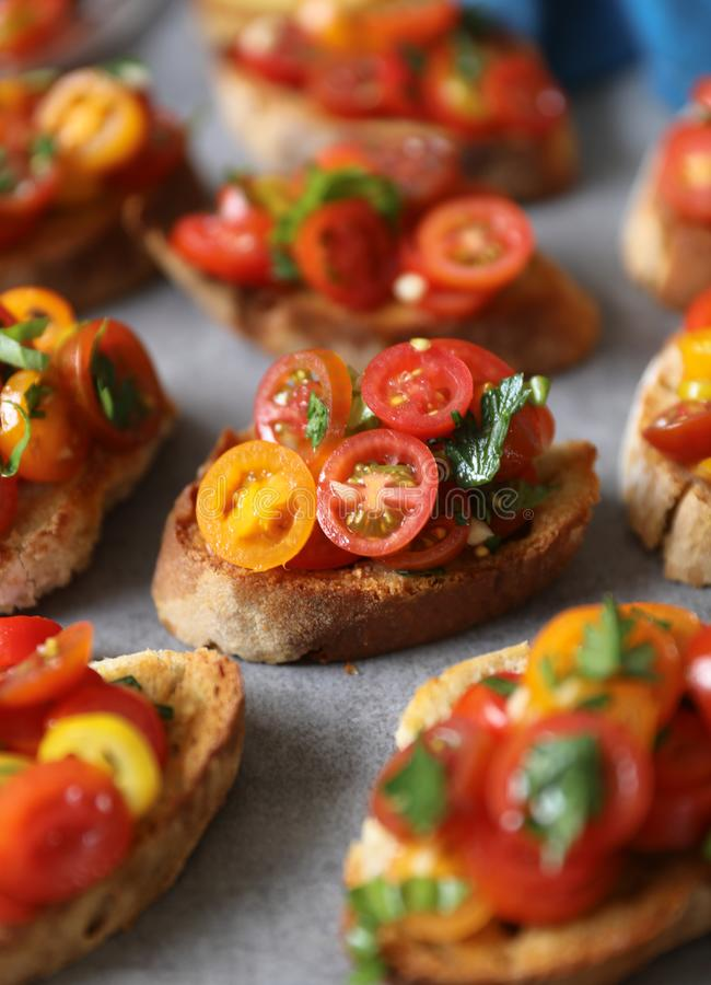 Bruschetta with tomatoes, basil and parsley,  an Italian delicious savory  appetizer. royalty free stock images