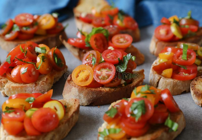 Bruschetta with tomatoes, basil and parsley,  an Italian delicious savory  appetizer. stock photography