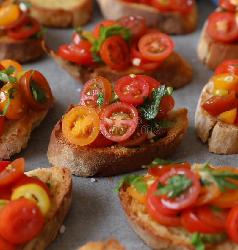 Bruschetta with tomatoes, basil and parsley,  an Italian delicious savory  appetizer. royalty free stock photos