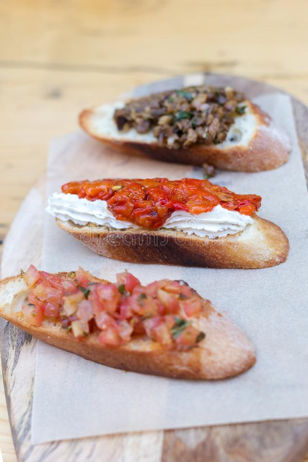 Bruschetta with tomatoes and herbs stock photo