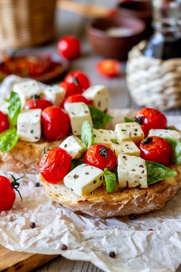 Bruschettas with tomatoes and cheese. Italian cuisine. Rustic style. Vegetarian food. Bruschettas with tomatoes and cheese. Italian cuisine. Simple style royalty free stock photo