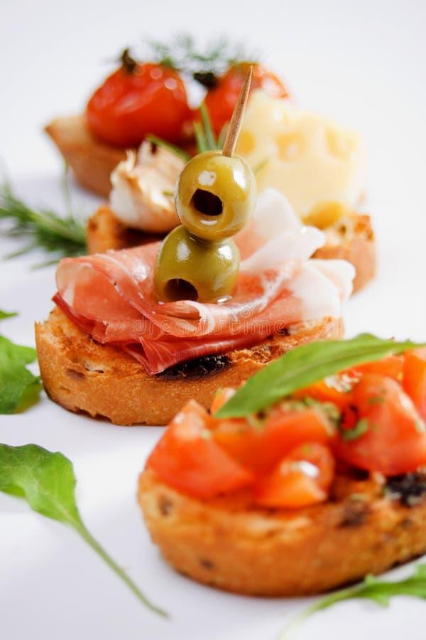Bruschette, alimento italiano tradicional do aperitivo imagem de stock royalty free