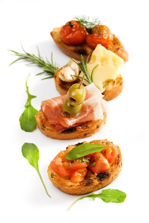 Bruschette, aperitivo italiano tradicional fotografia de stock royalty free