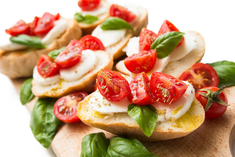 Italian bruschette, traditional appetizers stock photography