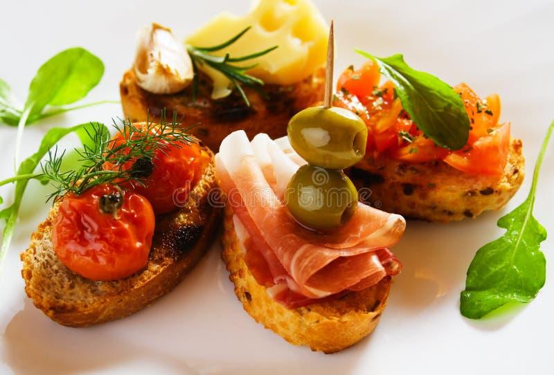 Bruschette, pão brindado italiano foto de stock