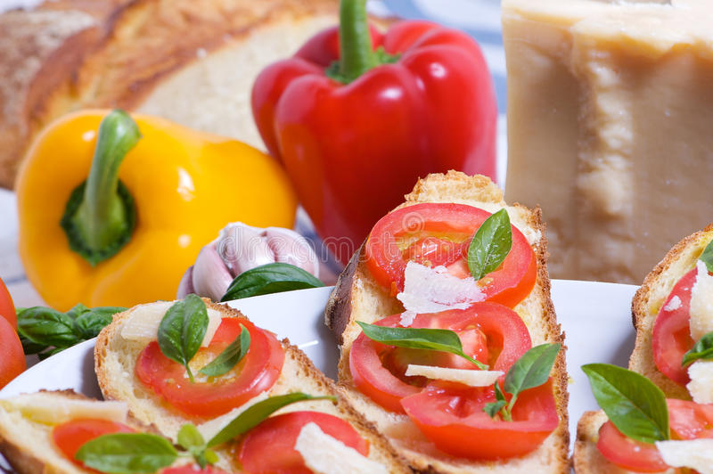 Bruschette with tomato, basil and cheese stock image