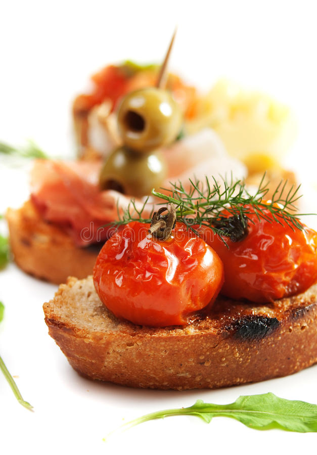Bruschette with tomato and olives stock photography