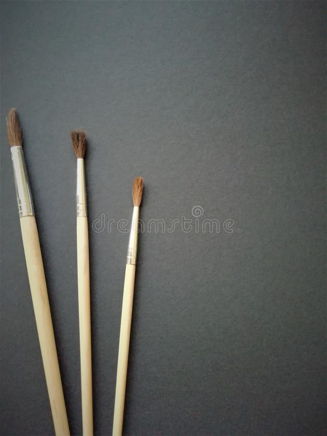 Brush on the black background with a place for text. Chancery stock photo