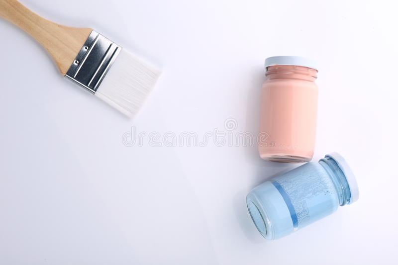 Brush and bottle glass of color for painting. Art stock images