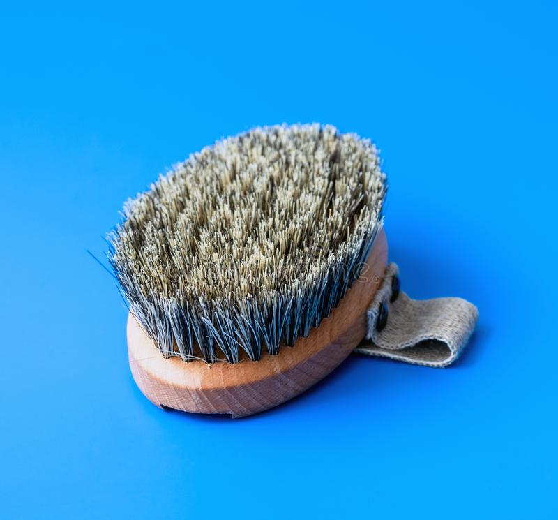 Brush with bristles made of horsehair on a blue background stock photography