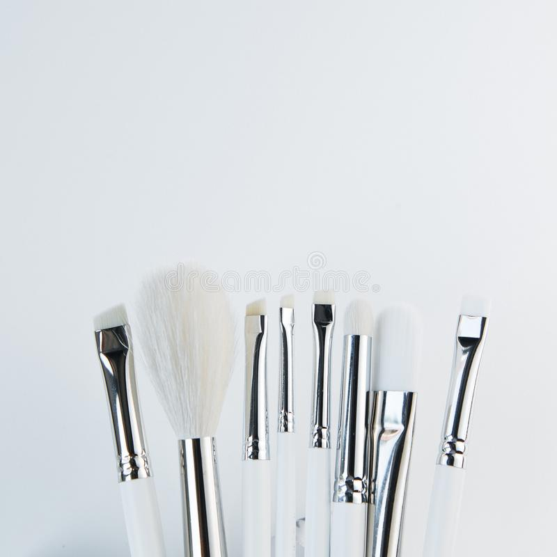 Brush brow and makeup artist in the set. Cut Bon and minimalism. Set of brushes and Flatley. Sterilization of instruments royalty free stock photo