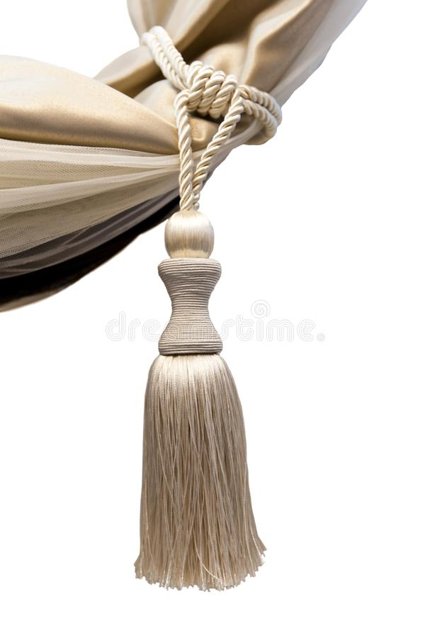 Brush for catching curtains - kutasy from natural beige silk on a white background stock image