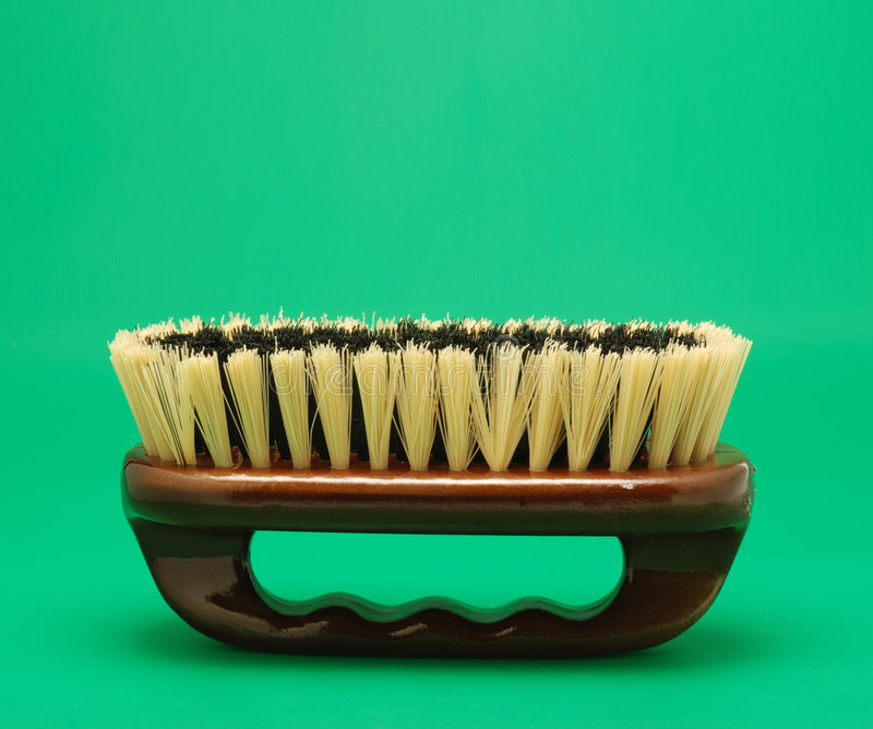 Brush for cleaning green background royalty free stock photos