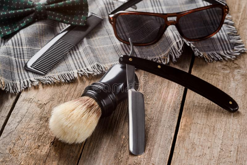 Brush, comb and plaid scarf royalty free stock photography