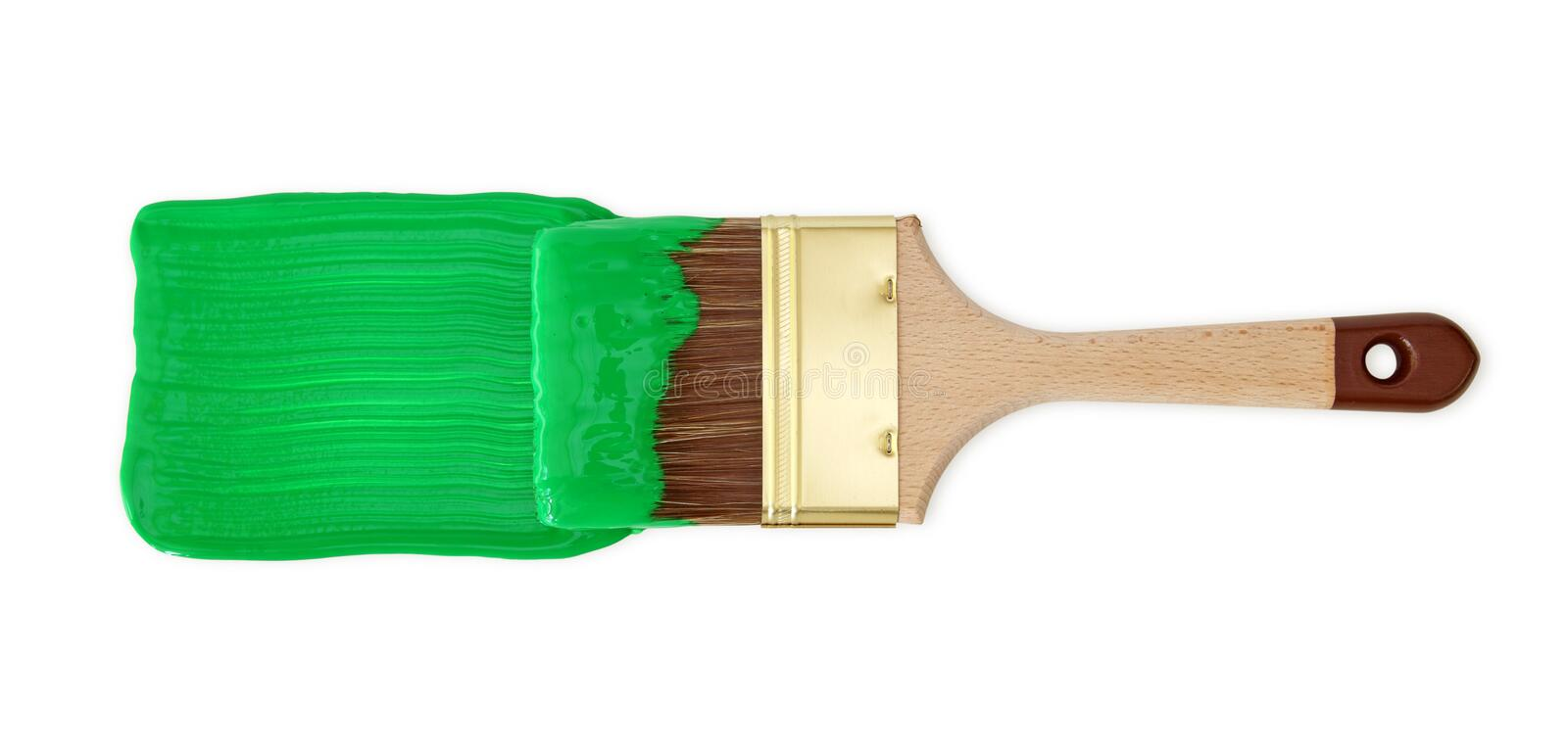Brush with green paint stock photo