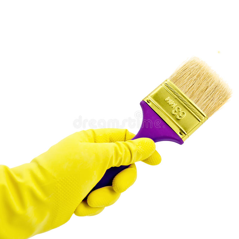 Brush in hand royalty free stock photography