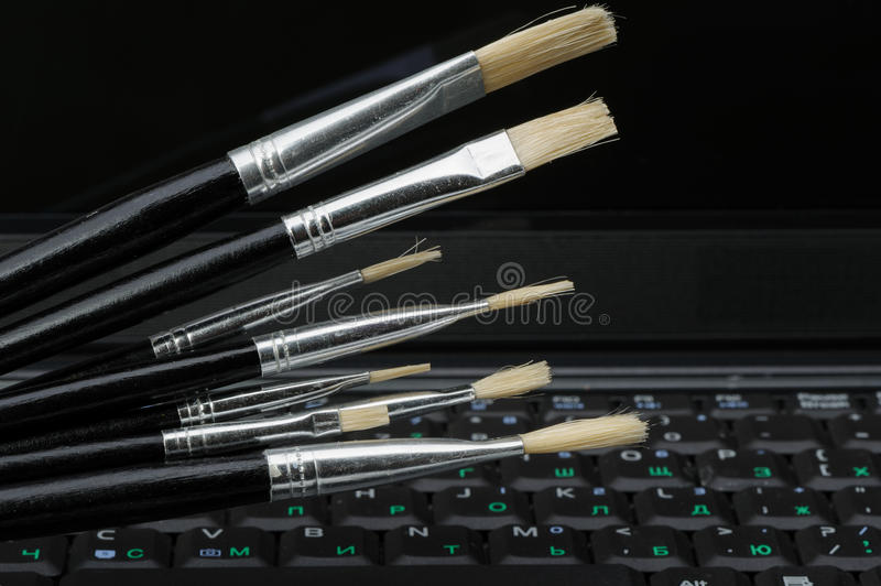 Brush And A Laptop Royalty Free Stock Photo