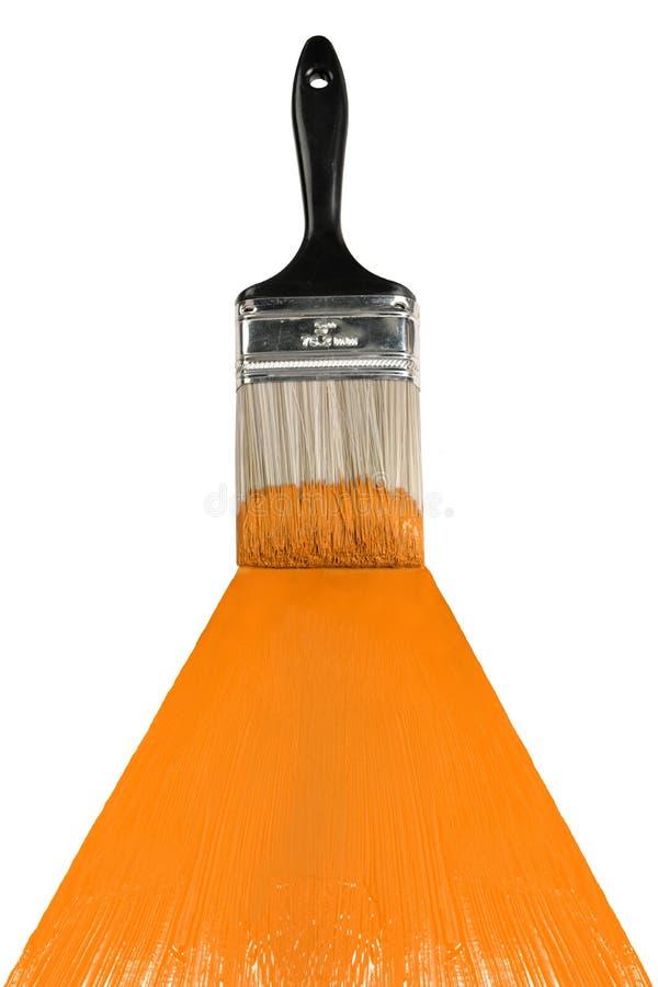 Brush With Orange Paint stock images