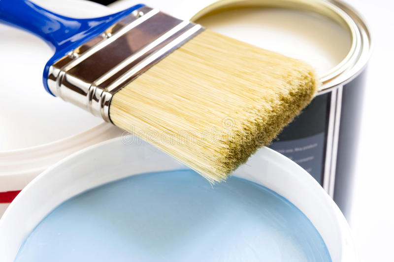 Brush and paint in banks on a white background stock photos