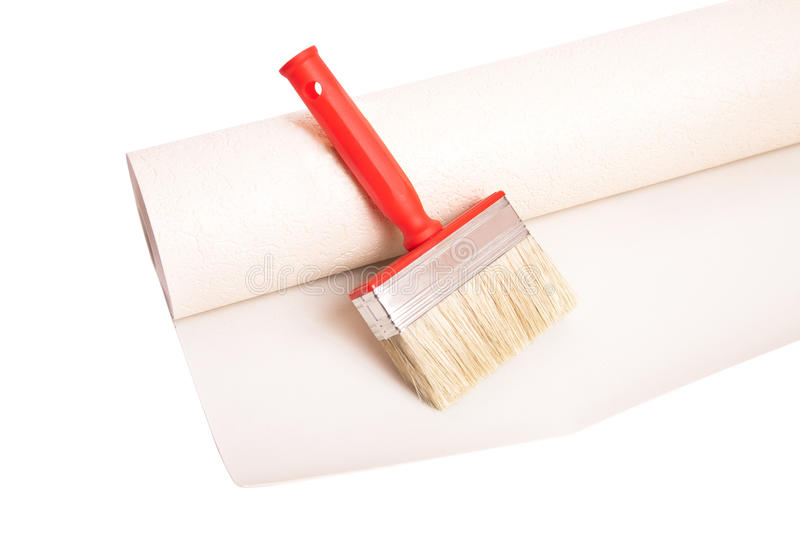 Brush and roll of wallpaper. Isolated on white background stock photo