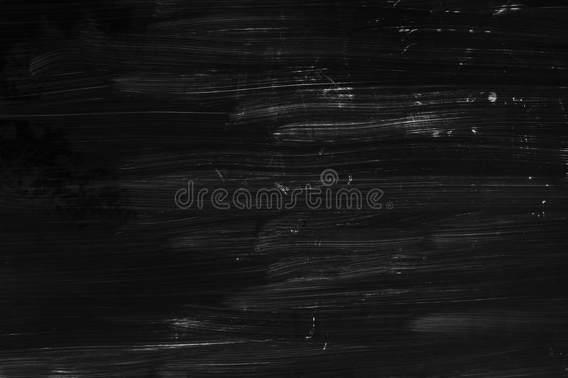 Brush strokes pattern, black wall texture. Abstract renovation background texture, brush strokes pattern over black wall stock photos
