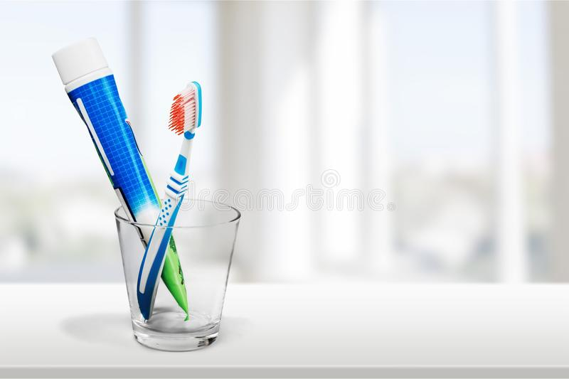Tube of toothpaste and a toothbrush on backgrouund. Brush tube tooth paste toothbrush toothpaste white stock photo