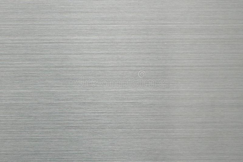 Brushed brushed aluminum surface. Empty abstract background of gray color royalty free stock photography