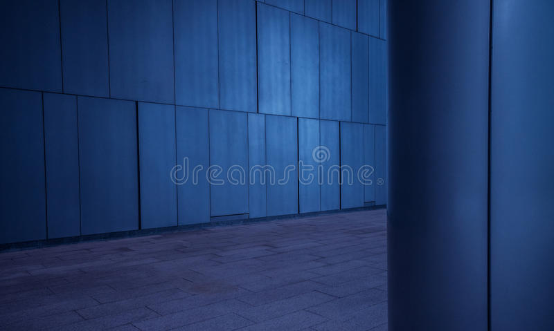 Brushed metal tiled panels wall and column background in modern futuristic architecture. Brushed metal tiled panels wall and column/pillar background in modern royalty free stock photo