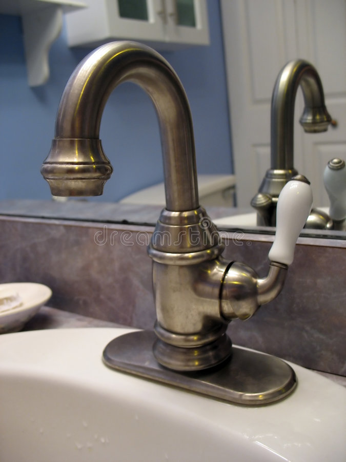 Brushed nickel faucet stock image. Image of ceramic, home - 1653681