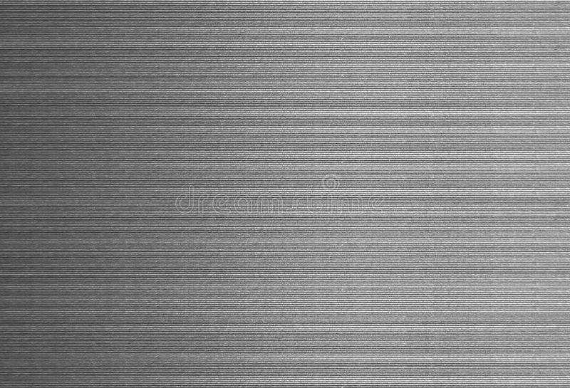 Brushed silver texture metal surface with metallic line. Clear Brushed metal texture background. Very useful for editing or fill with color royalty free stock image