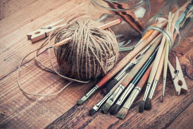 Brushes bundle on wooden background stock photography