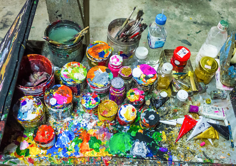 Brushes and cans of paint stock photo